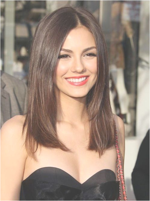 Straight natural brown hair cut below shoulders line This hairstyle is Wow