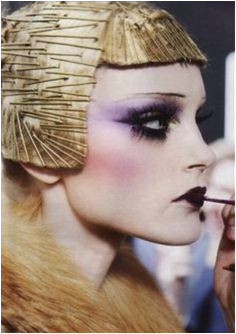 Dior 2009 Pat Mcgrath Makeup Artist extreme make up was inspired by the typical for the period bob haircut Jessica Stam at Dior runway