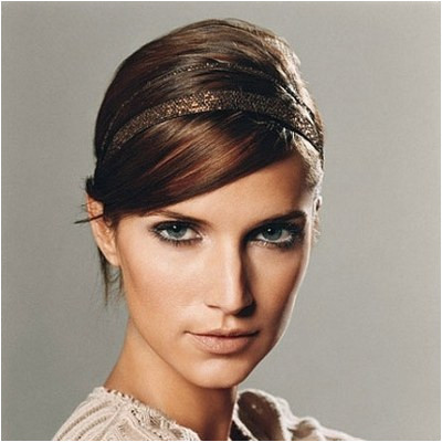 Full sideswept bangs hide wrinkles and instantly update your style says hairstylist Mark Townsend