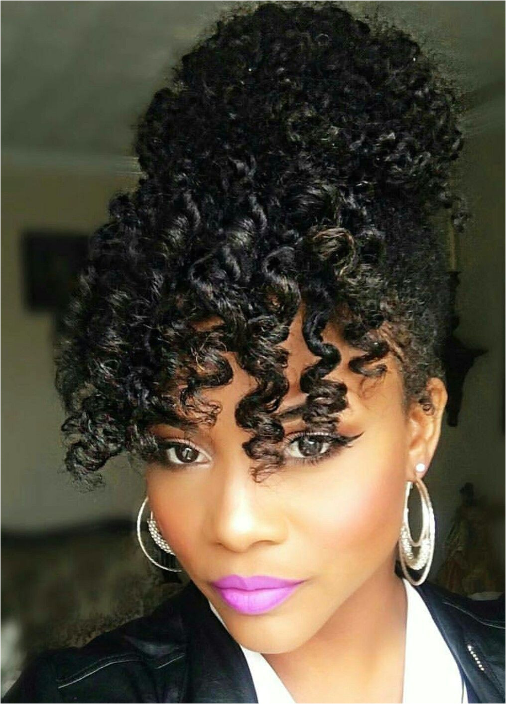 e of the cutest naturalhair hairstyles with a bun and bangs
