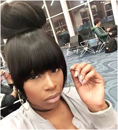 """Jacque Monae on Instagram """"Perfect top knot bun and heavy bangs I created rtinkf Hair by JacqueMonae Who s next JacqueMonae voiceofhair sewin"""