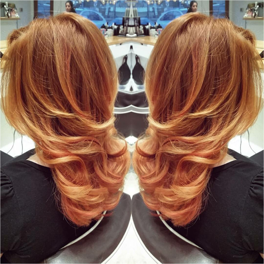 Blow out with curl on the bottom on gorgeous red gold hair Wavy blowout blow dry bouncy blowout style done at Blow Dry Westport by Annemarie