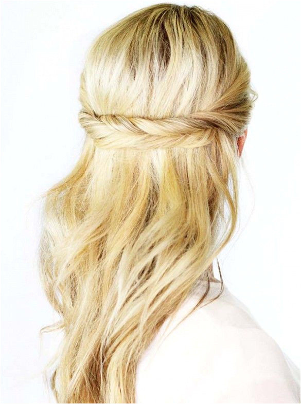 To recreate this look take a two inch section of hair on one side of your head then twist it towards the other Secure in place with a bobby pin