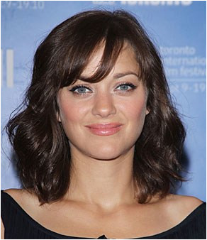 Marion Cotillard s sweet midlength hairstyle plements her forgiving fringe says Suave Professional celebrity