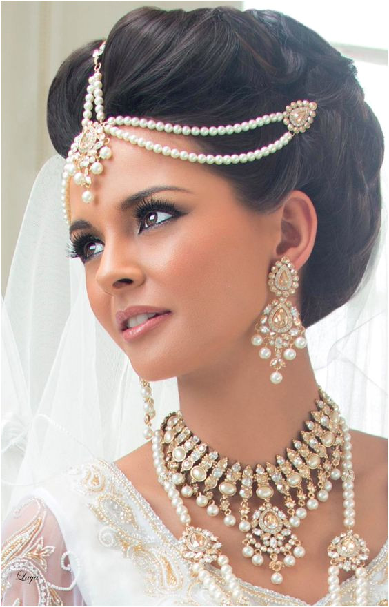 A neat up do for bride Bridal hairstyle for Indian Wedding