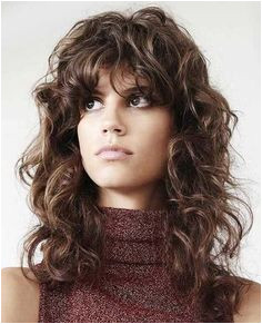 long curly shag hairstyle with bangs