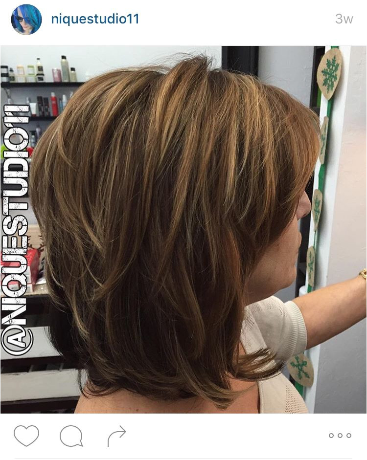 Short layered medium length haircut Lots of layers in this hair long bob lob Medium golden brown base color with fine highlights throughout