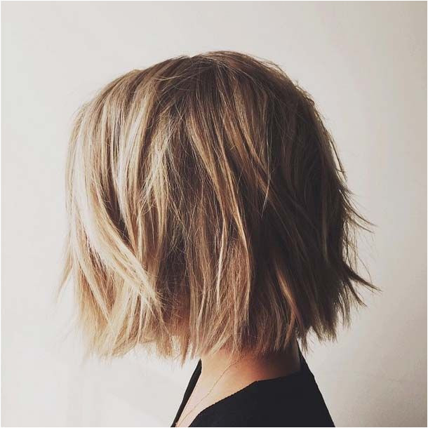 Thinking of chopping it all off for that non mom bob look You re going to want to read this