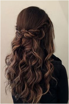 this half up half down look with a crown braid beach waves would look dreamy on any hair length and color