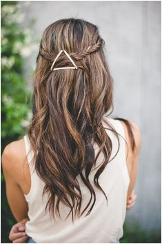 half up hair fishtail braid held tight with a shiny triangle of thick bobby pins