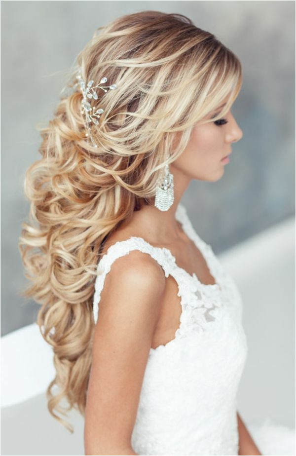 with gorgeous flowers we have created a beautiful collection of most romantic bridal updos for your wedding day Loose waves or a beautiful half up