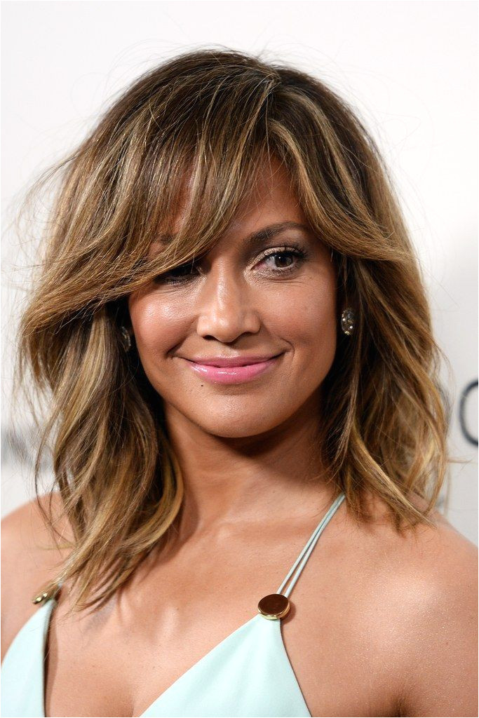 Not sure if you want to mit to full on bangs Try a tousled sideswept look like JLo