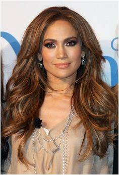 Jennifer Lopez Long loose waves brunette with layers and subtle highlights with a center part hairstyle pin it from carden