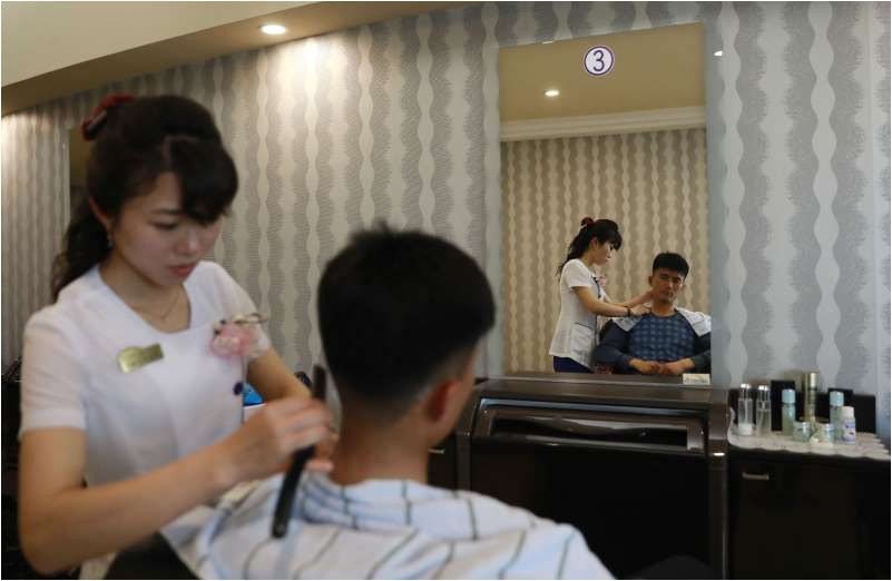A man s a haircut at a salon in Pyongyang Exclusive North Korea rules out negotiations on nuclear weapons November 17 2017