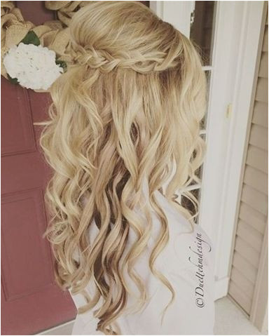 Take a look at the best wedding hairstyles half up half down in the photos below and ideas for your wedding Braided updo half up half down