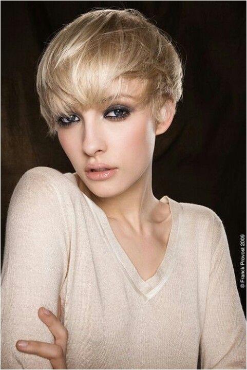 Short pretty dark blonde hair with highlights