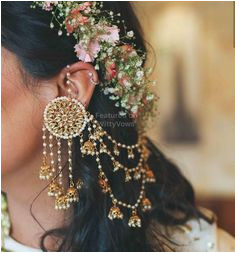 Floral crown and Statement earrings Mehendi look inspiration