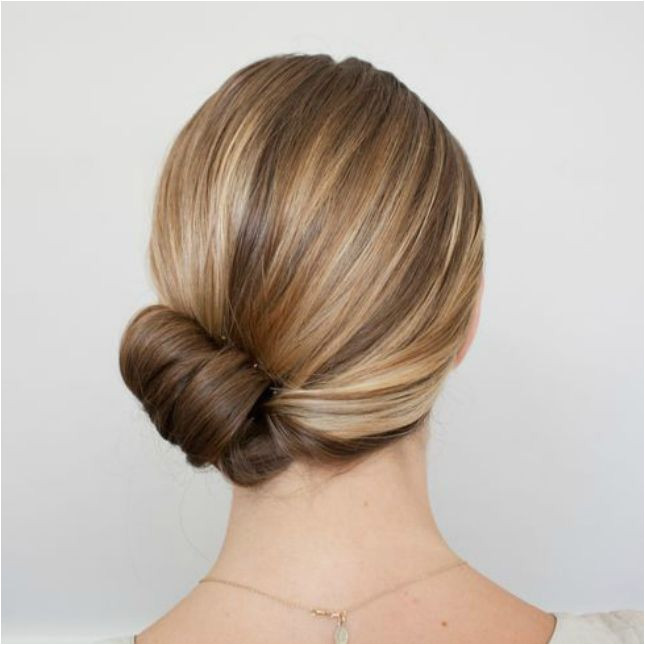 Sweep your strands to one side roll your ends up to create a barrel roll at the base of your neck to this glam holiday updo