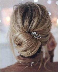 Create simple updo with Rahua Voluminous Dry Shampoo Wedding Bun Hairstyles Wedding Hair Chignon