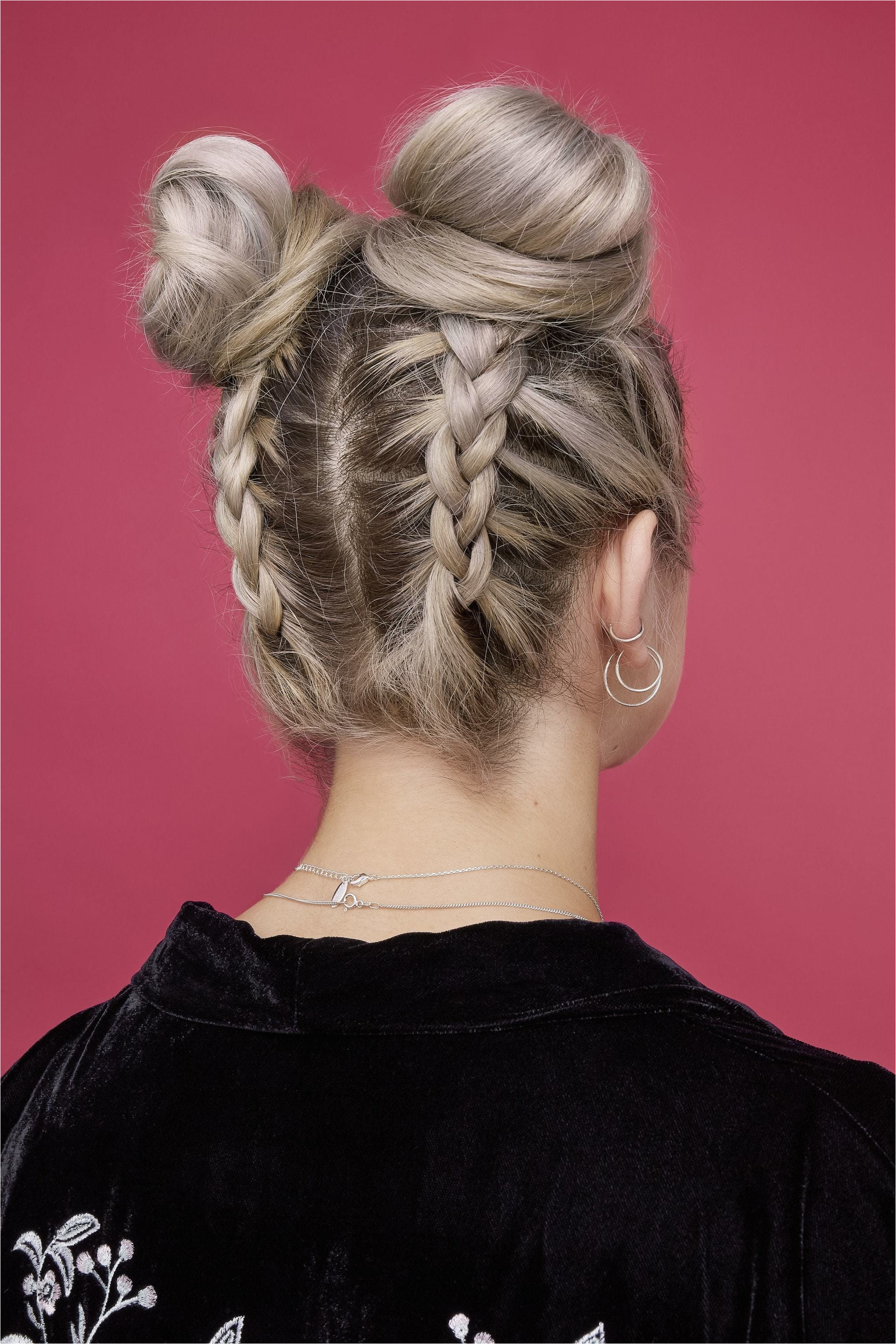 easy bun hairstyles back view of blonde model with hair styled in two double braided