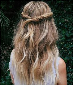 Twisted half up half down hairstyle with loose waves for a bohemian and romantic