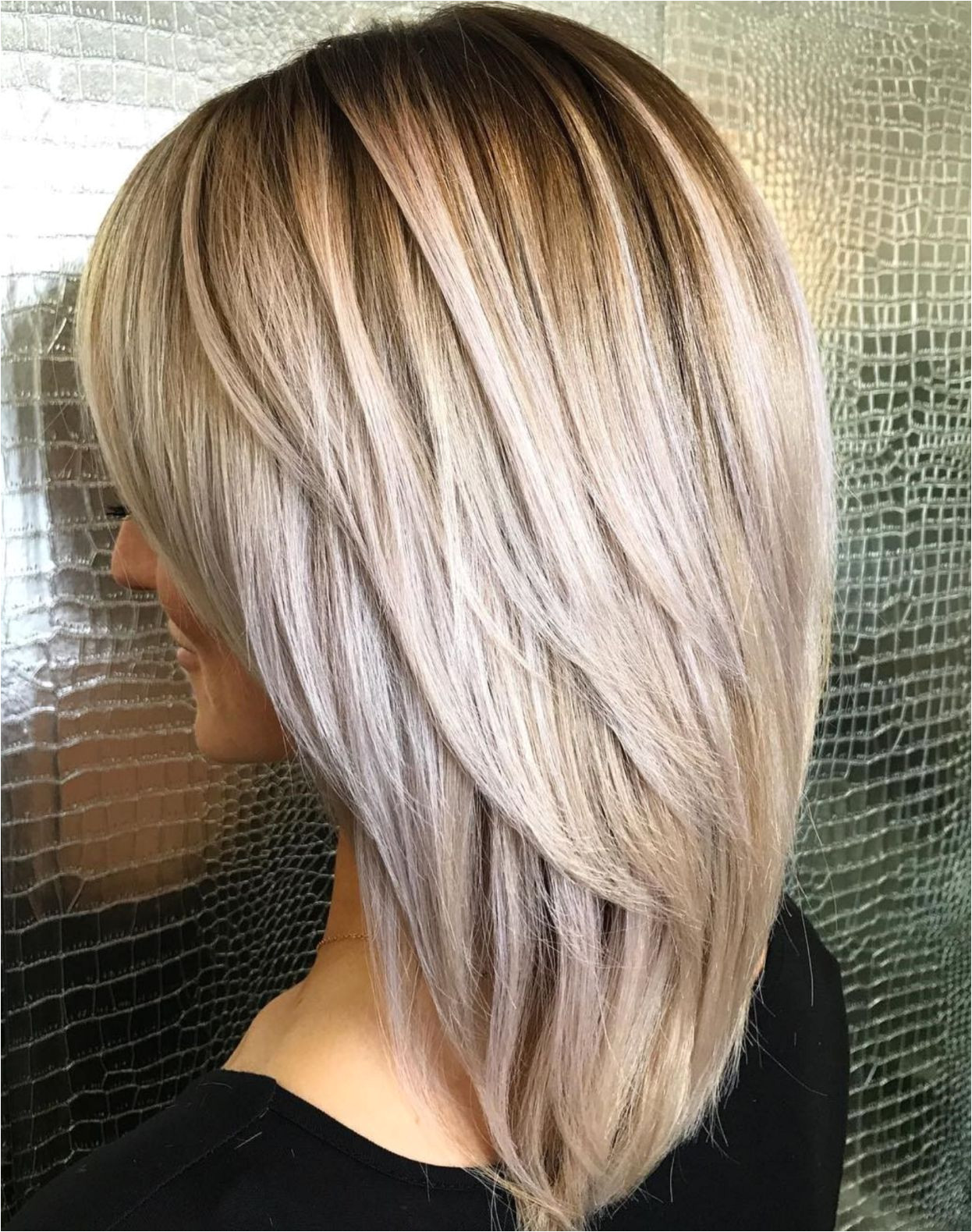 Medium Haircut With Long V Cut Layers