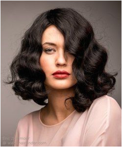 Vintage inspired shoulder length bob hairstyle with waves More