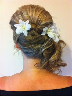 Bridesmaid side hair style from Book My Makeup & Hair Book My Makeup & Hair