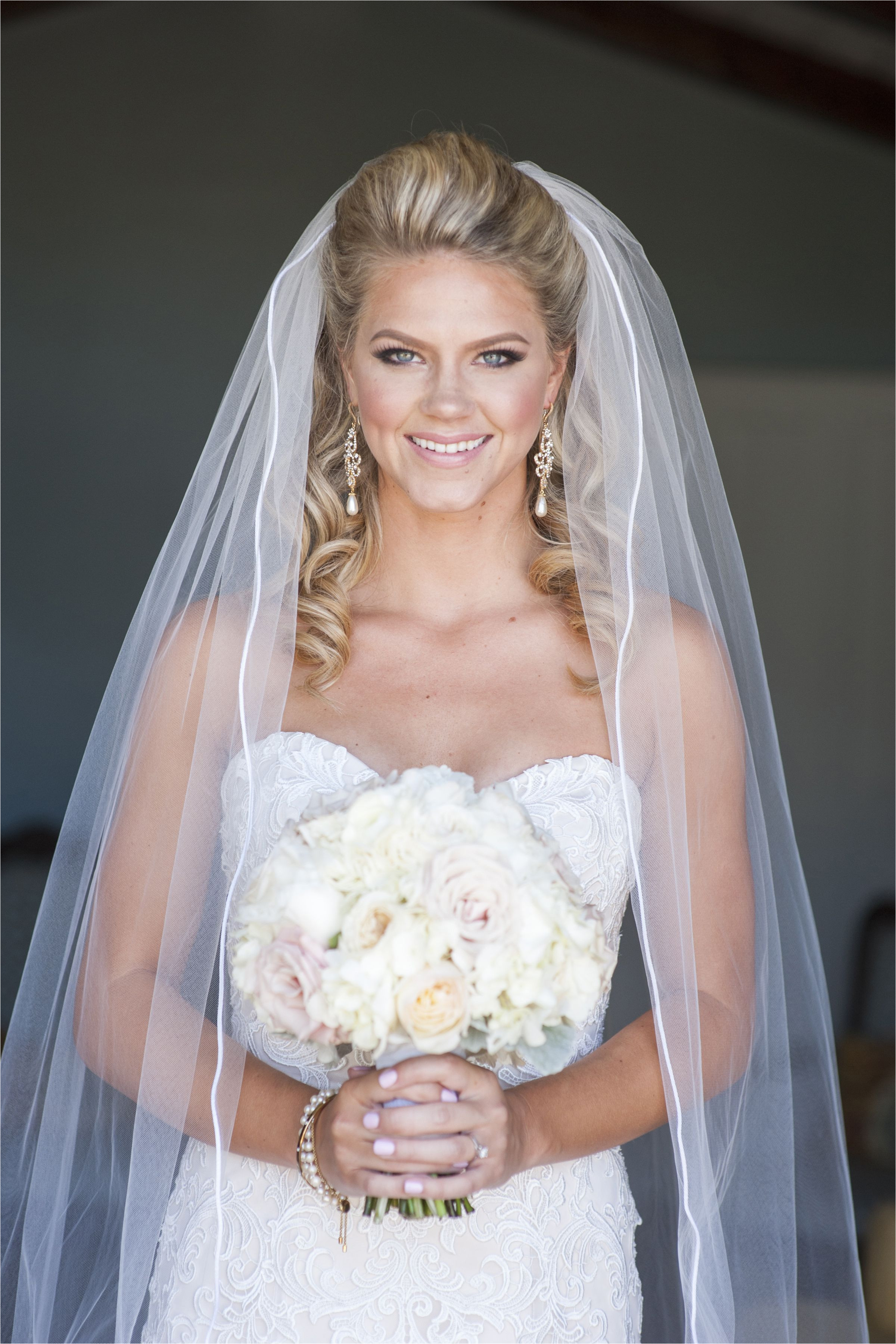 bride dress wedding down bouquet silhouette cathedral veil make up hair half up half down