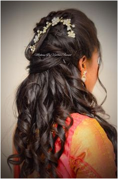 Indian bride s reception hairstyle by Swank Studio Bridal updo Curls Saree Blouse Design