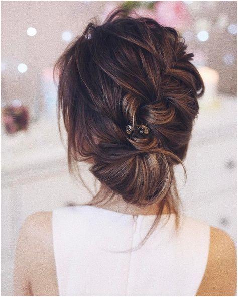 Beautiful braided and twisted updo wedding hairstyle for romantic brides Get inspired by this braid updo bridal hairstyle updo messy wedding hairstyles