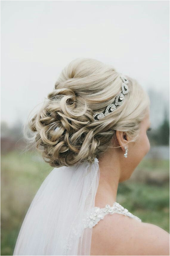 Wedding updo with headband and veil underneath