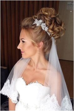 Image result for bridal updos with headpiece and veil underneath Weddinghairstyles