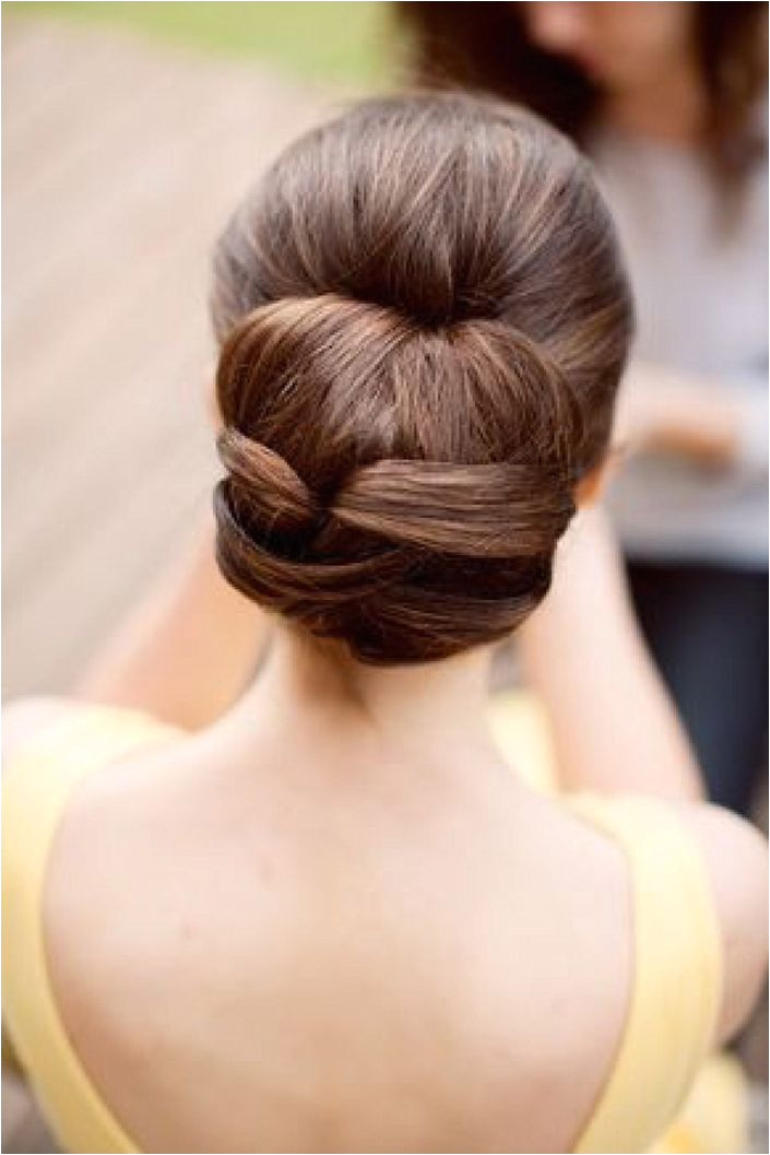 Neat and classic bun hairstyle idea for your wedding day For more inspiration visit