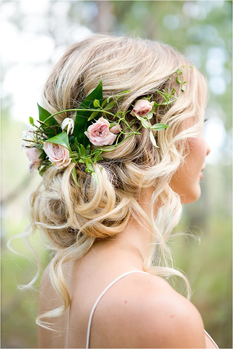 This romantic wedding hair idea includes a half halo of roses and is a beautiful