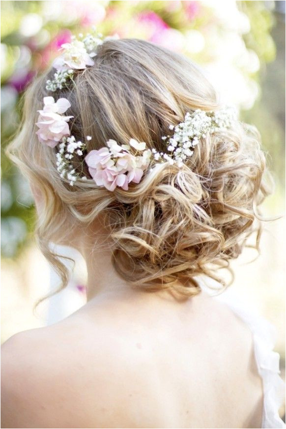 Wavy Curly Updo Wedding Hairstyle With Flower Crown I like the romantic hairdo and flowers but maybe with just a couple on the side not a whole crown