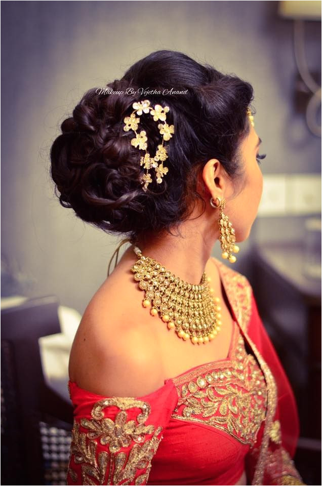 Indian bride s reception hairstyle by Vejetha for Swank Studio Bridal updo Bridal lehenga