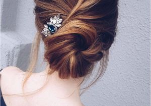 7 Wedding Updo Hairstyles This Pretty Updo Wedding Hairstyle with Hair Accessories Perfect for