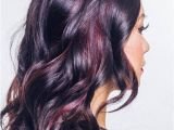 Black Hairstyles with Red Highlights Glossy Black Waves with Muted Burgundy Highlights