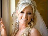 Bridal Hairstyles Half Up Half Down with Veil and Tiara Bride with Wavy Hair and Tiara Wedding Hairstyles