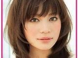C Cut Hairstyle with Bangs Feathered Layered Hairstyles