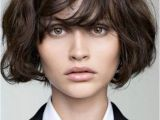 Curly Bob Haircuts with Bangs 22 Y Short Hairstyles for Wavy Hair Cool & Trendy