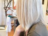 Feather Cut Hairstyle for Girls toning with All Over Highlights On A Natural Dirty Blonde