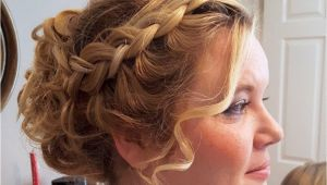 Flower Girl Bun Hairstyles Curly Updo with Chunky Plaits Perfect for Girls with Thick Hair