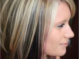 Hairstyles Dyed Underneath Highlights with Color Blocked Black and Purple Underneath Cute but
