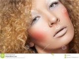 Hairstyles for Curly Hair and Big Nose Creative Style Model with Curly Hair Fun Make Up Stock