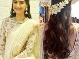 Hairstyles for Curly Hair while Wearing Saree Side Parted Hairstyle with Gajra