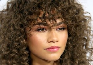 Hairstyles for Curly Hair with Side Bangs 11 Cute Bang Styles to Try Allure
