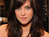 Hairstyles for Damaged Bangs Jessica Stroup with Side Swept Bangs and Wavy Medium to Long Hair