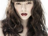 Hairstyles when Bangs are Growing Out Voluptuous Brown Wavy Hair with Straight Bangs